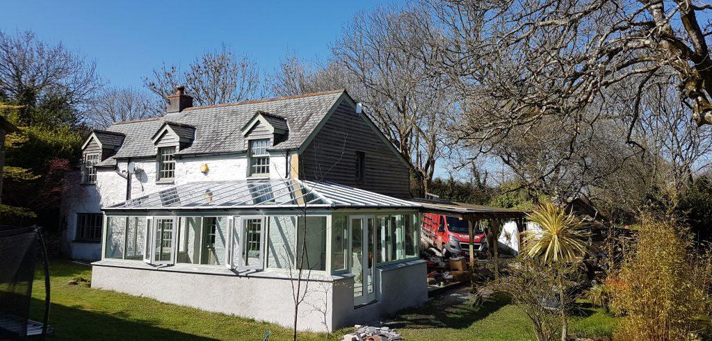Timber conservatory including energy saving double glazed units